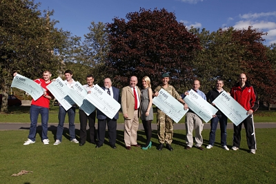 Alec Lucas Memorial Trust presents cheques to local sports club and to the army