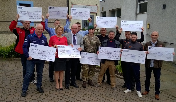 Photo of groups receiving cheques