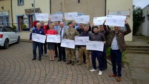 Presentation to local teams and military charities